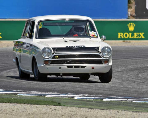 Steven Lawrence with 1966 Lotus Cortina in Group 4B - 1961-1966 GT Cars under 2500cc at the 2015-Rolex Monterey Motorsport Reunion, Mazda Raceway Laguna Seca