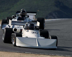 Larry Savage driving his March 76B in Group 2 at the 2015 HMSA Spring Club Event at Mazda Raceway Laguna Seca