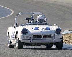Darlyn LinkawithPettenati with 1964 Triumph Spitfire in  Group 1 at the 2015 Season Finale at Thunderhill Raceway