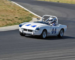 Darlyn Linka-Pettenati driving a 1964 Triumph Spitfire at the 2015 CSRG Thunderhill Rolling Thunder at Thunderhill Raceway