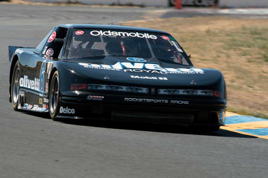 Gordon Johnson with 1991 IMSA GTO Olds Cutlass Supreme in Group 13 at the