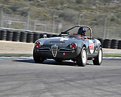 Peter Inshaw with 1963 Alfa Romeo Guilia Spider 1600 in Group 4B - 1961-1966 GT Cars under 2500cc at the 2015-Rolex Monterey Motorsport Reunion, Mazda Raceway Laguna Seca