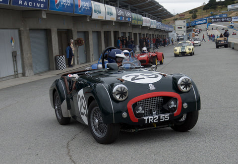 David Nelson driving his Triumph TR2 in Group 1 at the 2015 HMSA Spring Club Event at Mazda Raceway Laguna Seca