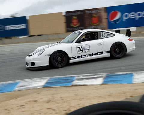 Wade Carter driving his Porsche 911 Cup in Group 7 at the 2015 HMSA Spring Club Event at Mazda Raceway Laguna Seca