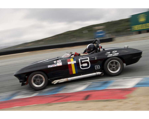 Jeff Abramson driving his Chevrolet Corvette in Group 6 at the 2015 HMSA Spring Club Event at Mazda Raceway Laguna Seca