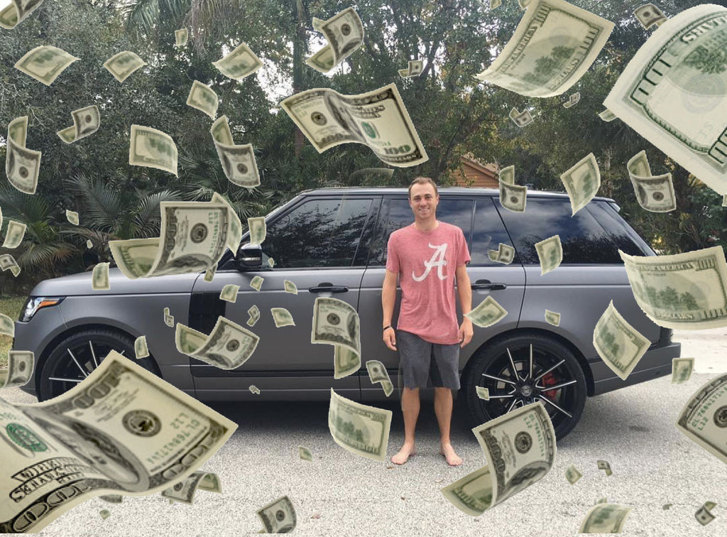 Professional American golf player Justin Thomas with his car