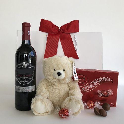 Wine, plush bear and chocolates gift