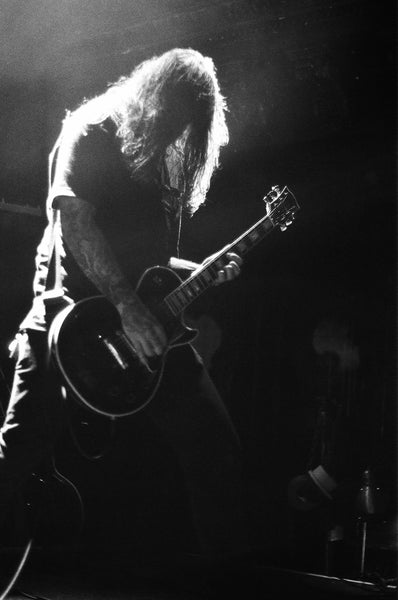 black and white photo of Amenra guitarist by Benedetto Manzella