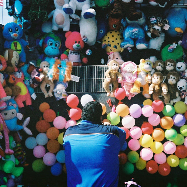 Man from back, staring at colorful balloons by Daniel Alvarez