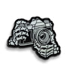 35mm Film SLR Camera Skeleton Hands Glow in the Dark Lapel Pin - Shoot Film Co.
