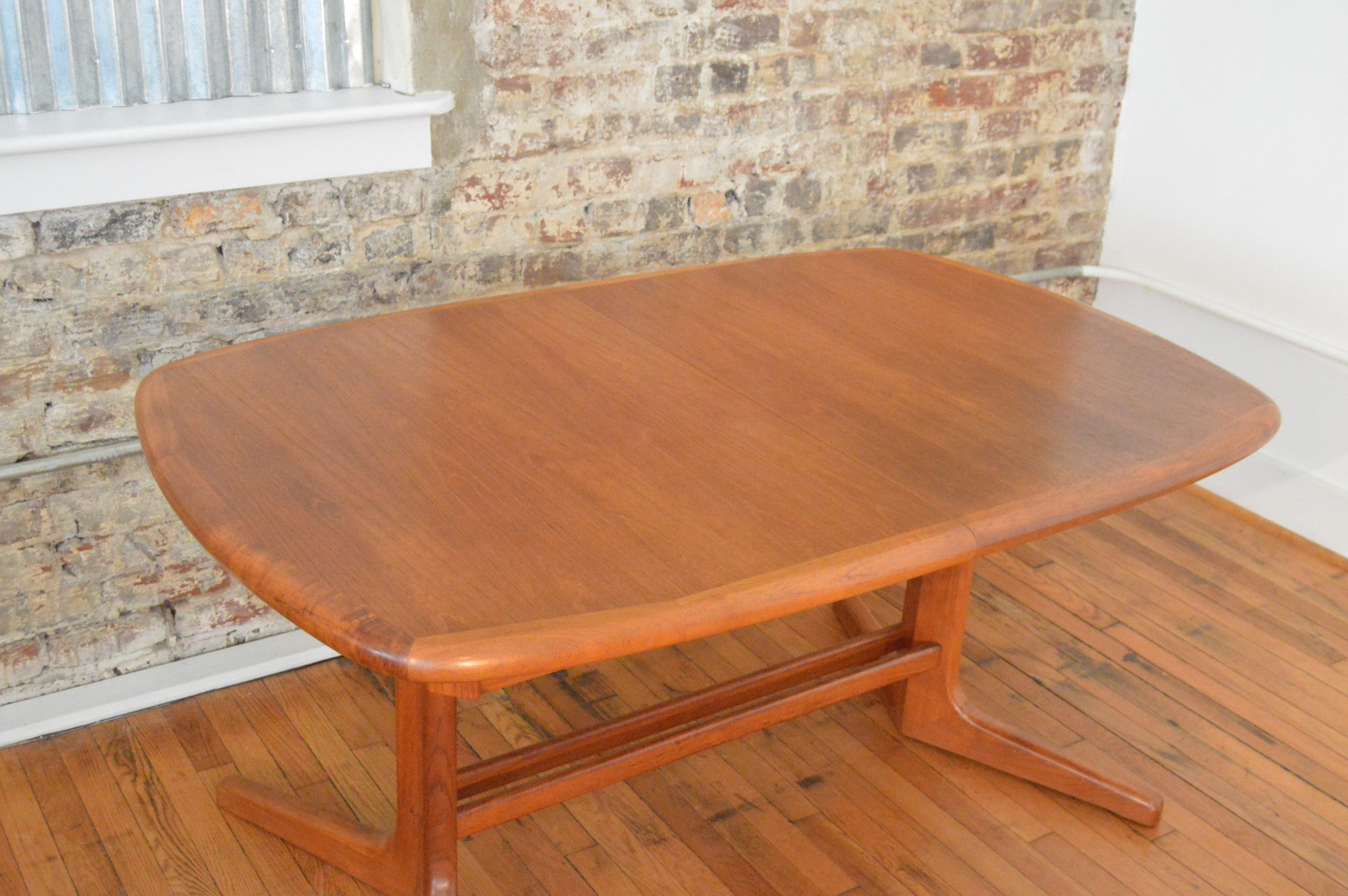 danish teak trestle base dining table with butterfly leaf