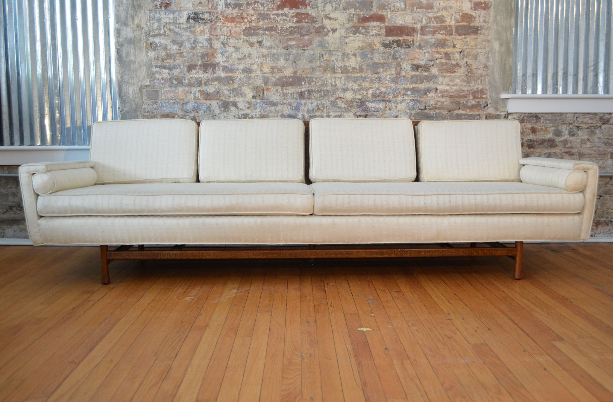 Elegant mid century modern sofa with greek key design for Mid century modern danish furniture