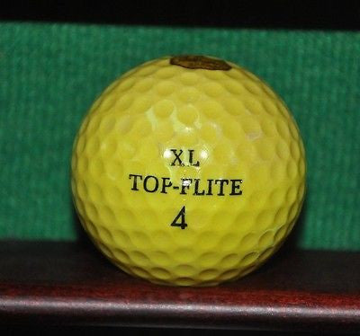 Vintage Cal Fruit Brand yellow golf ball.