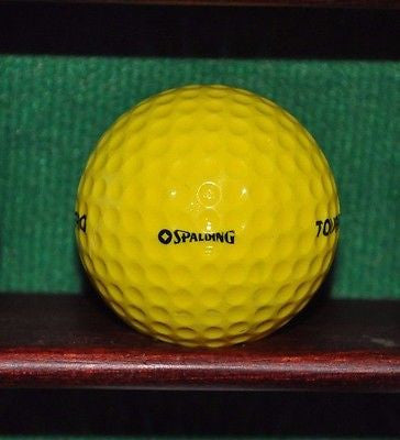 Spalding Touring Pro golf ball. Yellow