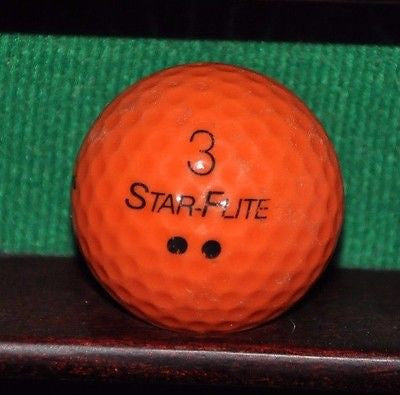 Vintage Orange Spalding Star Flite golf ball with Totem Pole logo.