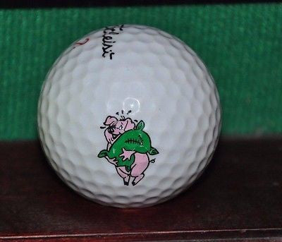 Pig with a sack of money logo golf ball. Titleist