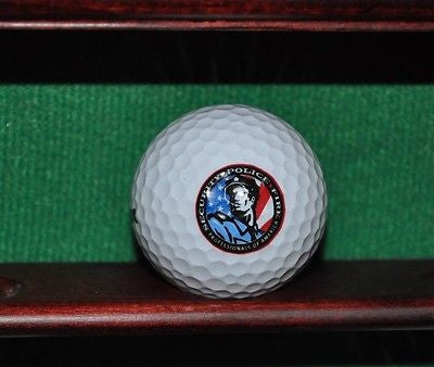 Security Police Fire Professionals of America logo golf ball. Excellent.