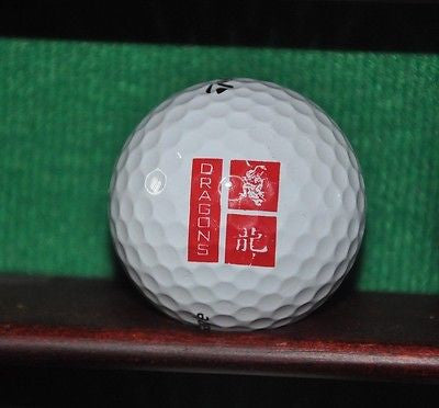 Dragon logo golf ball. TaylorMade Penta