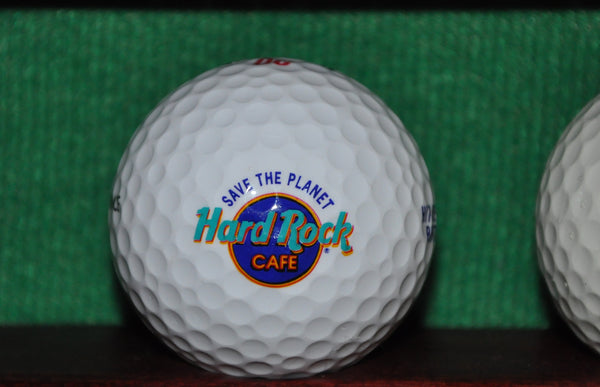Hard Rock Cafe ' Hit Me With Your Rhythm Stick ' Logo Golf ball. Precept