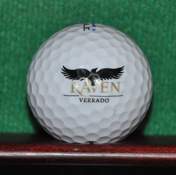 The Raven Golf Club at Verrado Arizona logo golf ball.