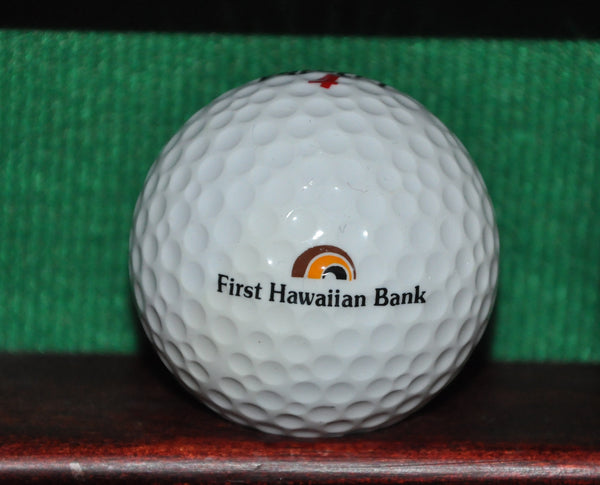 First Hawaiian Bank logo golf ball.