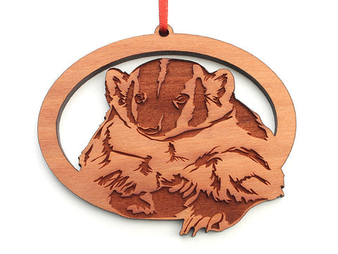 Badger Oval Ornament - Nestled Pines