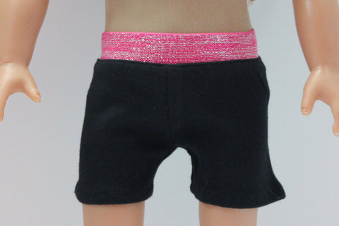 Black sport shorts with pink metallic waistband