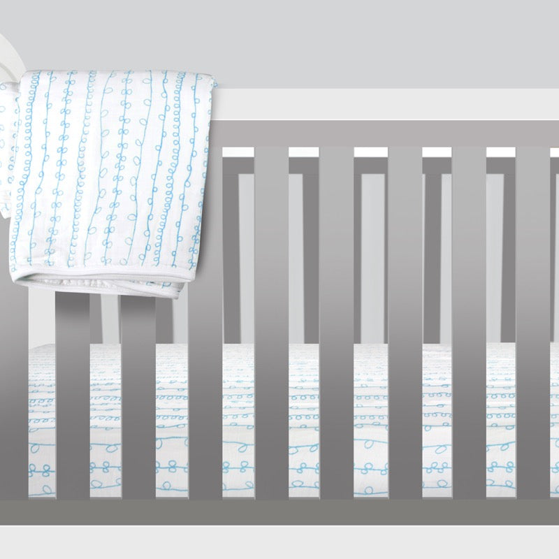 Magnolia Organics Organic Cotton Muslin Crib Sheet - Curly Qs
