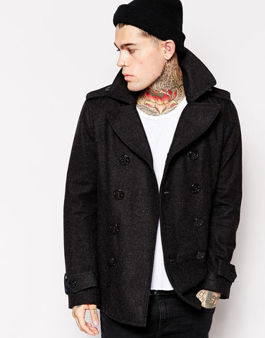 tattoo man wearing black coat and beany