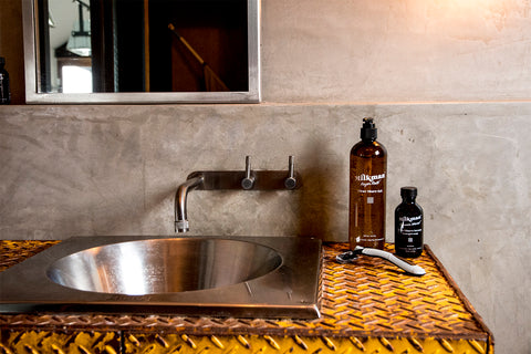 razor clear shave gel and after shave serum on industrial bathroom sink