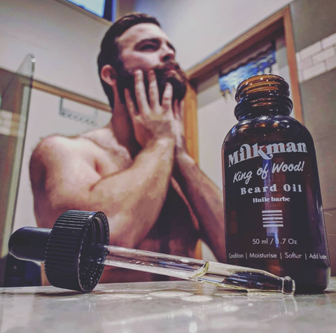 bearded man using beard oil