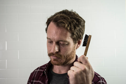 moustache man holding moustache brush