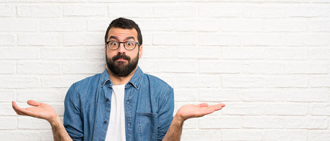 bearded man in questioning pose