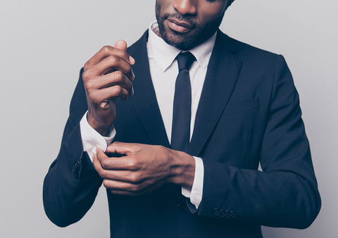 man with stubble wearing suit