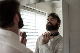 bearded man using milkman beard beast beard comb