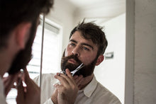 Load image into Gallery viewer, bearded man using beard scissors
