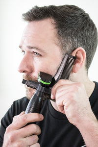 bearded man using beard stencil