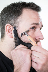 bearded man using beardrometer beard shaper