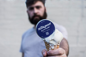 bearded man holding vanilla beard balm
