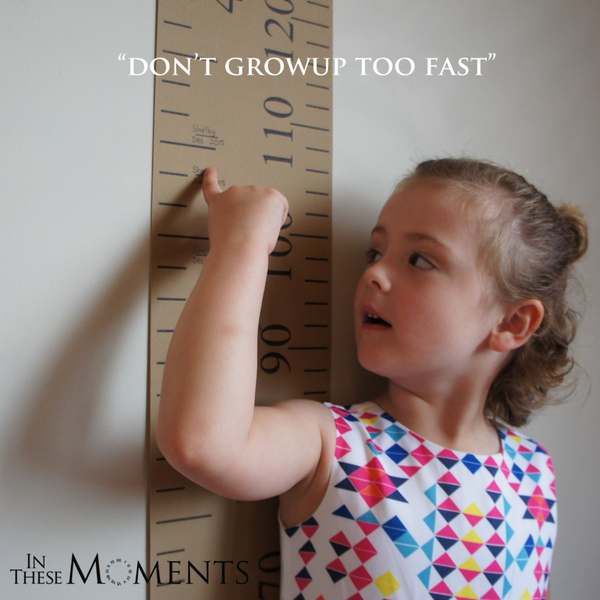 Girl being measured on Growscroll Growth Chart
