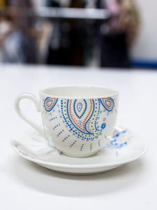 Handmade porcelain tea cup and plate
