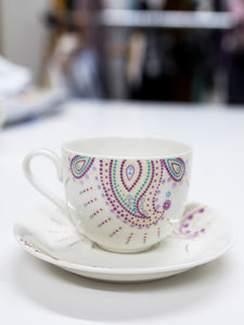 Porcelain tea cup and plate