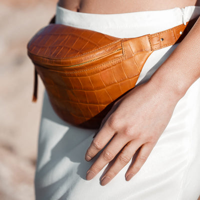 Small cognac leather belt bag with crocodile print DAPHNY RAES