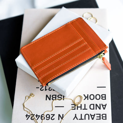 Slim orange leather women's zipper card holder with golden zipper DAPHNY RAES