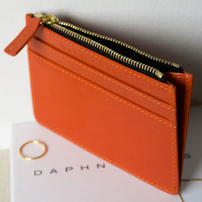 Small orange leather women's zipper wallet with multiple card slots DAPHNY RAES