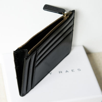 Slim smooth black leather women's credit card holder with antique golden zipper DAPHNY RAES