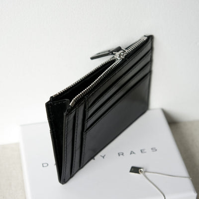 Slim black smooth leather women's credit card holder with multiple card slots and zipper DAPHNY RAES