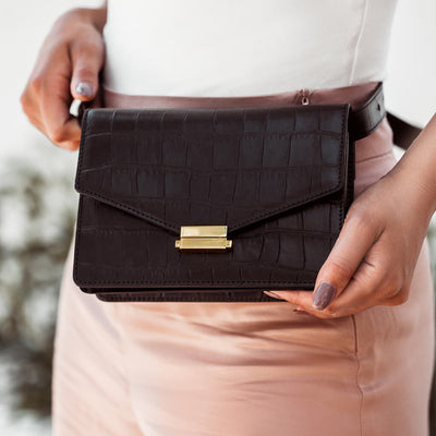 Black leather waist bag with crocodile print DAPHNY RAES
