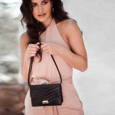 Black leather mini purse with gold lock DAPHNY RAES