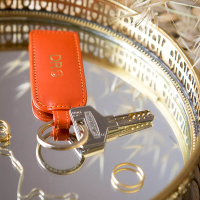 Personalized orange keychain with silver ring and monogram